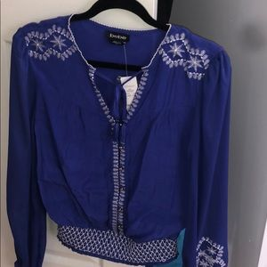 BEBE Blouse. Long sleeve with sheer Arms
